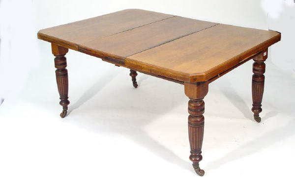 21: Victorian walnut wind-out dining table with extra l