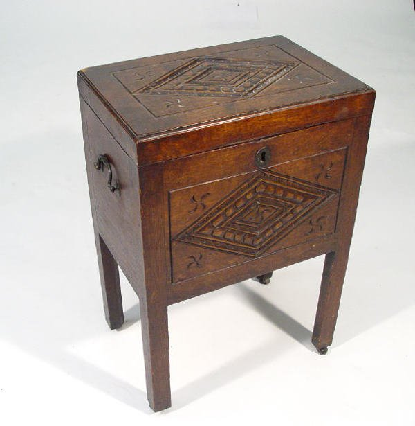 24: 19th Century oak cellarette, the hinged lid and thr