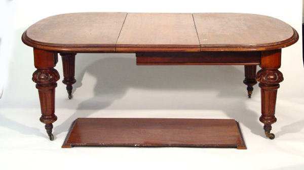 52: Victorian walnut wind-out dining table on carved an