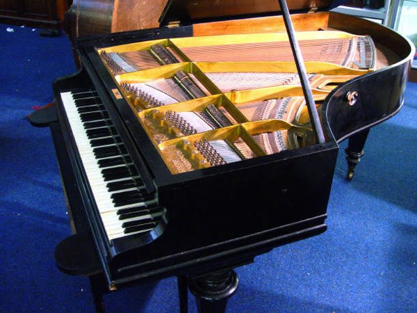 68: Ebonised C Bechstein baby grand piano with matching