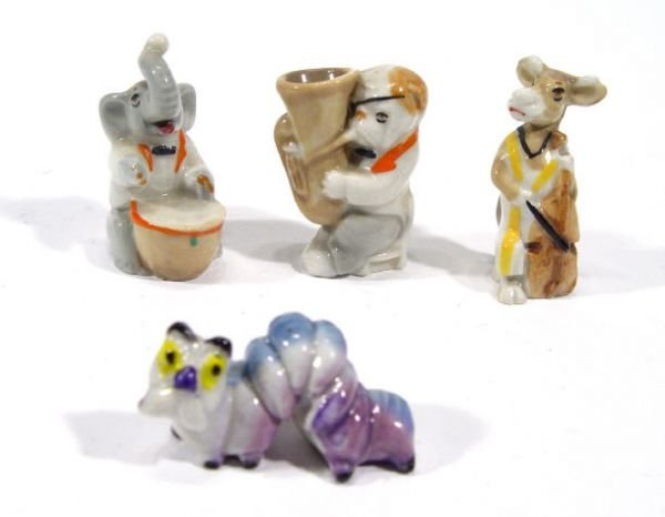500: Four hand painted Wade figures - Jem, Clara, Chunk
