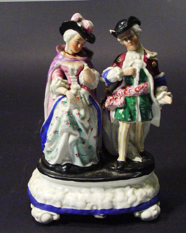 552: Hand painted Continental porcelain figure group on