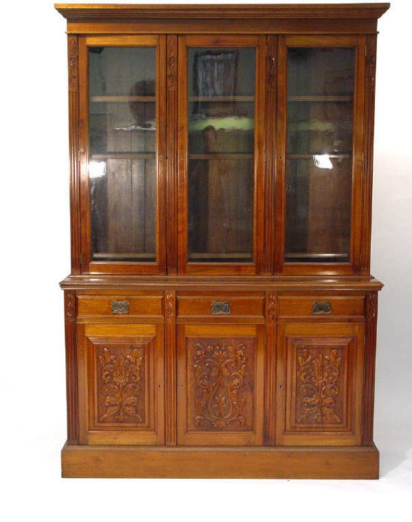 1: Victorian walnut three section bookcase, the upper p