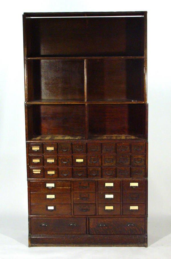 4: Oak Globe Wernicke style modular bookcase, fitted th