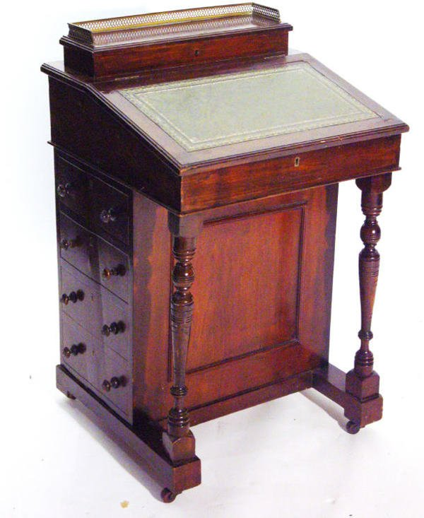 5: Late Victorian mahogany Davenport with brass gallery