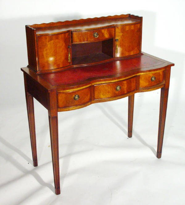 18: Mahogany Serpentine front desk with galleried top a