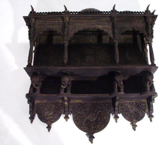 19: Indian ebonised hardwood wall hanging shelf with th