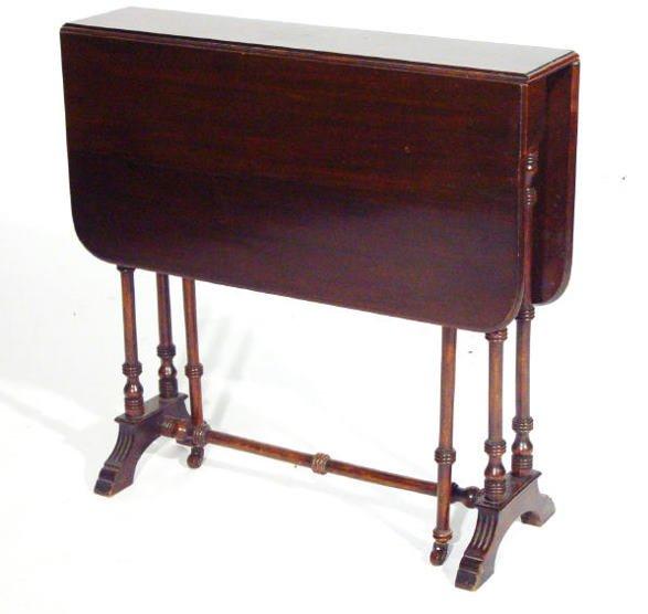 21: Edwardian rectangular mahogany Sutherland table on
