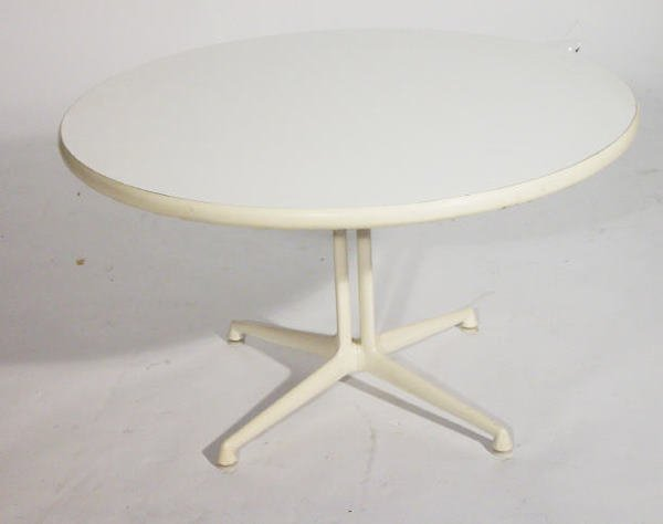 23: Herman Miller circular coffee table on a white pain