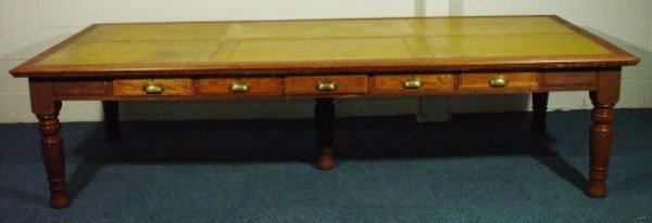 10: Large oak library table with tooled gold leather in