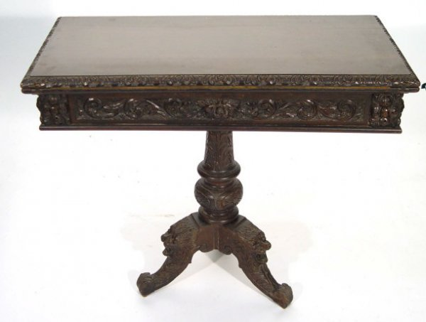 14: Oak foldover card table with swivel top, heavily ca