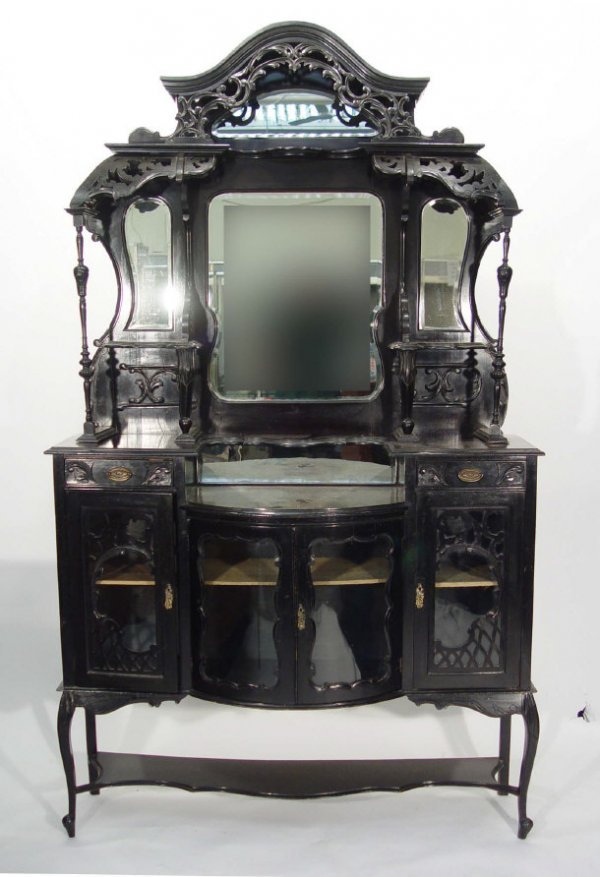 21: Victorian ebonised mirrored back cabinet with heavi