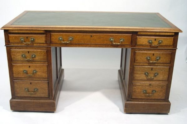 10: Edwardian oak twin pedestal desk with green tooled