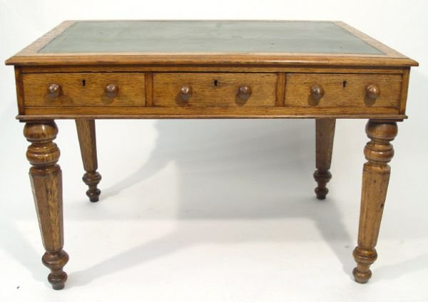 13: Victorian oak desk with green tooled leather insert