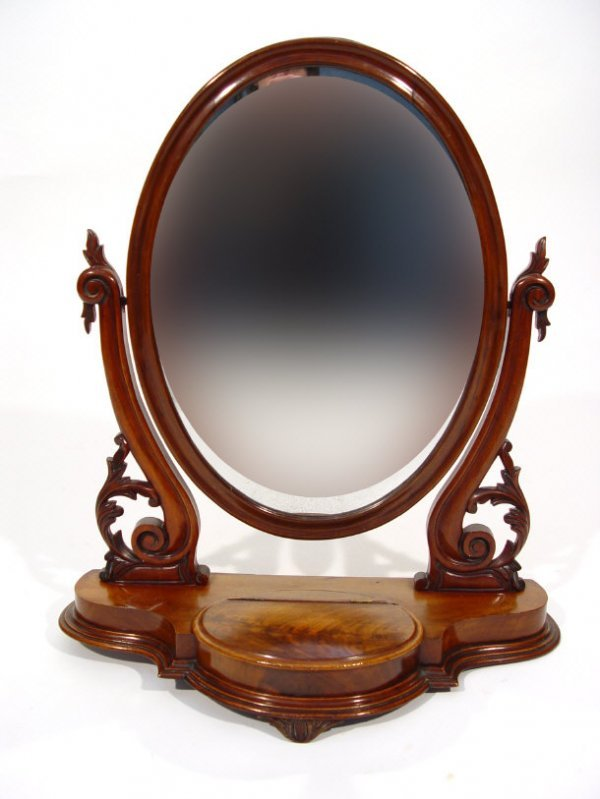 16: Victorian mahogany framed toilet mirror, the oval m
