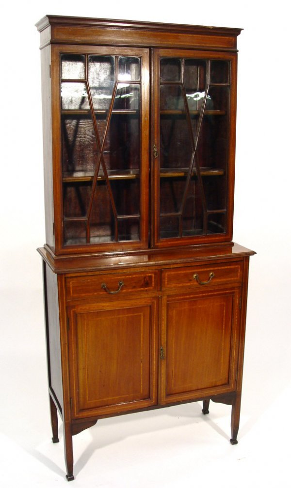 21: Edwardian inlaid mahogany bookcase with moulded cor
