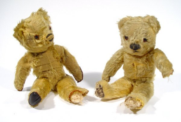 704: Two 1930's jointed golden teddy bears, each 28cm h