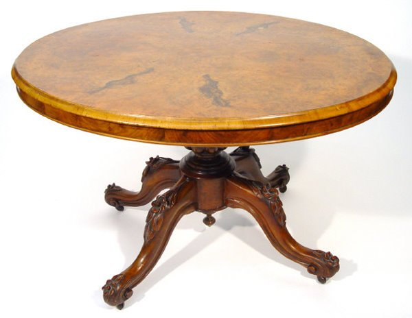 9: Victorian oval snap top walnut table with well figur