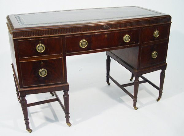 14: Mahogany kneehole desk with bow front and black too