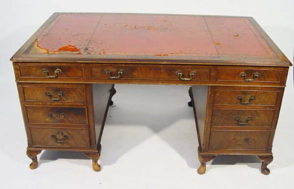 17: Reproduction mahogany twin pedestal desk with red t