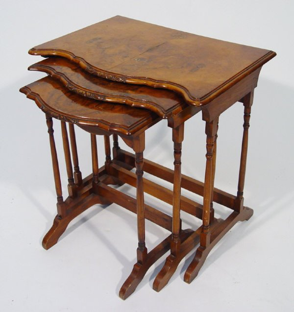 18: Nest of three walnut occasional tables with carved