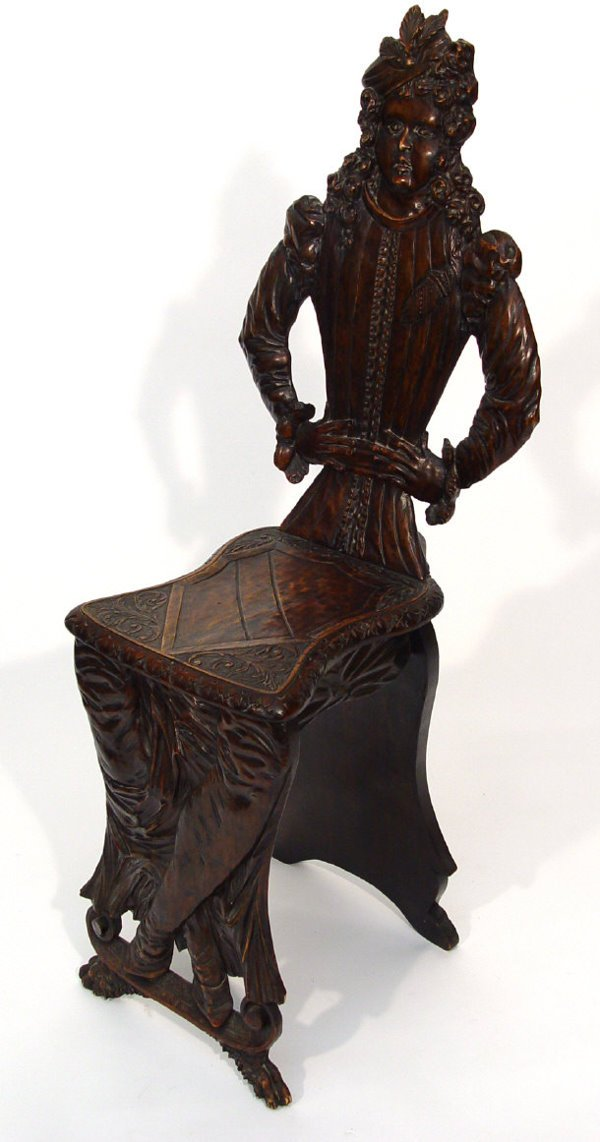 31: Mahogany hall chair, carved with a figure with leaf