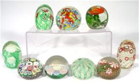 371: Nine colourful glass paperweights with millefiore,