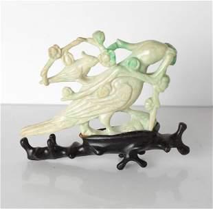 Chinese Jadeite sculpture of birds with flowering