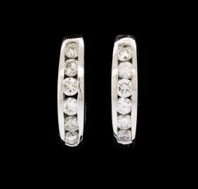 14KT White Gold 0.50ctw Diamond Huggie Earrings