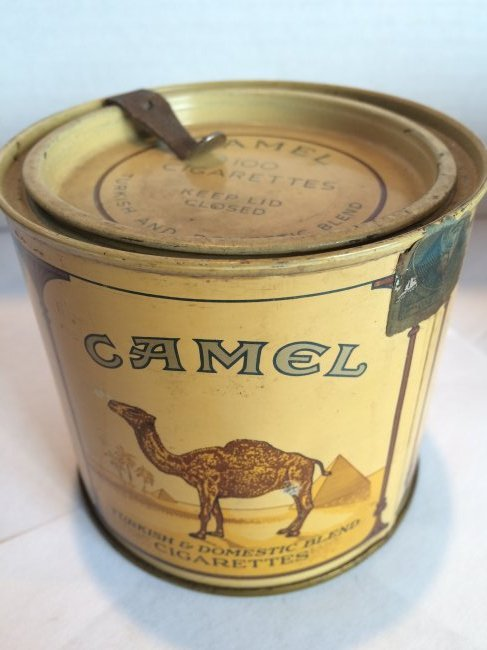 CAMEL 100's ROUND TIN EMPTY WITH LID AND OPENER 1975