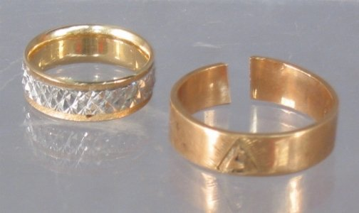 2588: TWO 14K GOLD BANDS. One appears to be a men's rin