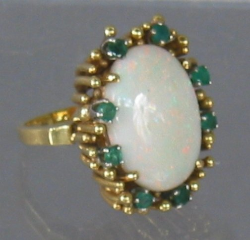 2589: 18K OPAL(?) RING. The ring has a large oval cut o