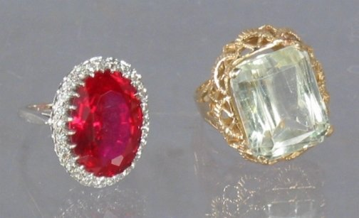 2591: TWO 14K RINGS. One ring has a large square cut st