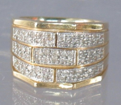 2594: 14K DIAMOND BAND. The ring has three rows of roun