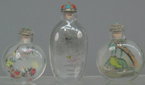 2598: THREE GLASS SNUFF BOTTLES. All have reverse paint