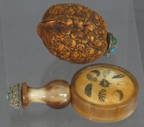 2599: TWO SNUFF BOTTLES. One is a carved walnut snuff b