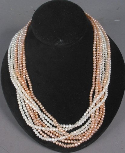 2601: TORSADE PEARL NECKLACE. The necklace has six stra