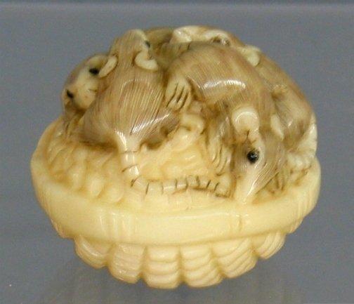 2603: RATS IN A BASKET NETSUKE. The bone netsuke has fo