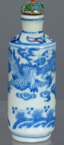 2605: CERAMIC SNUFF BOTTLE. The bottle has a blue and w