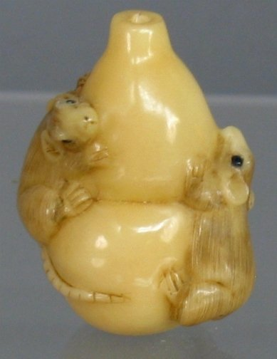 2606: RATS & VASE NETSUKE. The bone netsuke has two rat