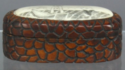 2607: WOOD & SCRIMSHAW BOX. The box has a carved wood b