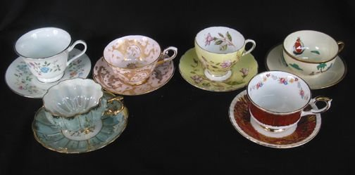 3094: 6 CUPS AND SAUCERS. (1) Garden party pattern with