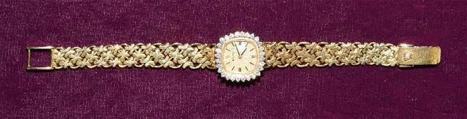 ROLEX 14K YELLOW GOLD AND DIAMOND LADIES WATCH, 6.25''