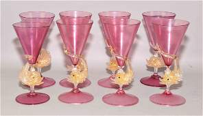(8) VENETIAN GLASS GOBLETS WITH DOLPHIN STEMS, ruby