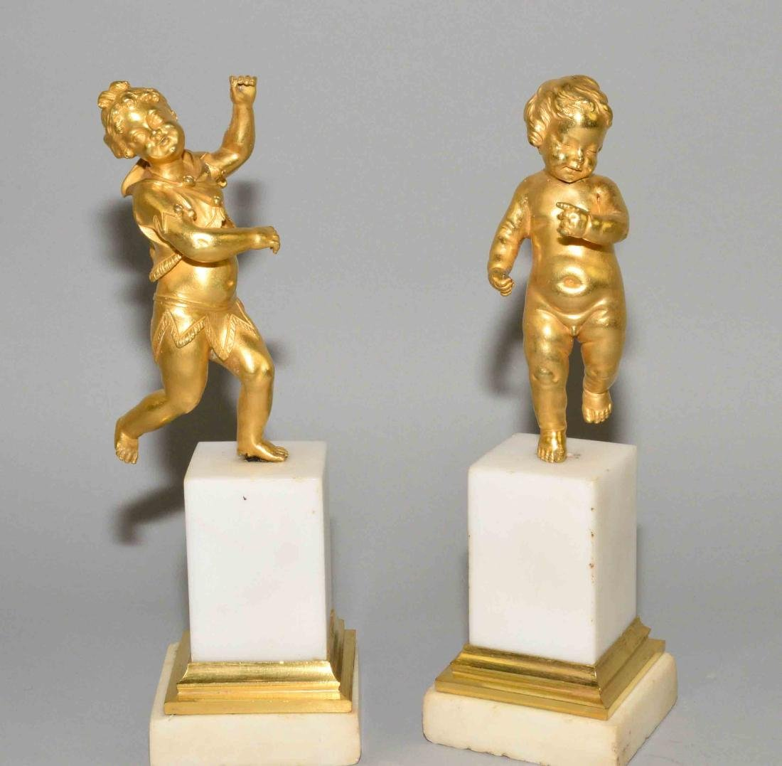 PAIR OF GILT BRONZE FIGURES OF PUTTI, late 19th C. on a