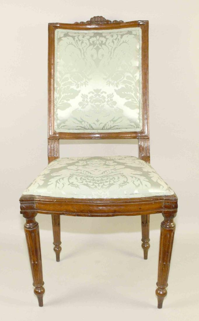 LOUIS XVI CARVED FRUITWOOD SIDE CHAIR, late 18th C.