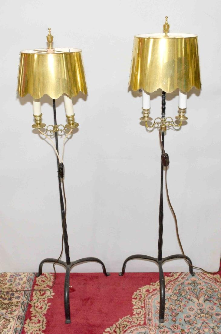 PAIR OF IRON AND BRASS TRIPOD FLOOR LAMPS with