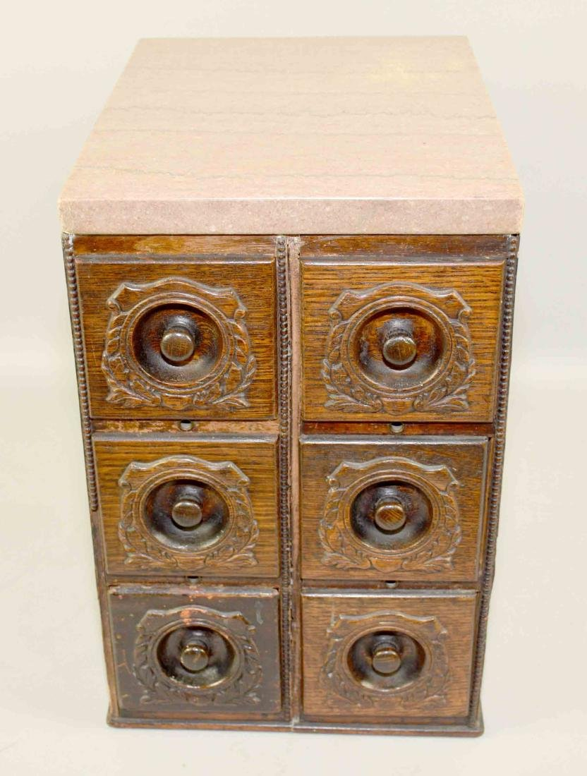 MARBLE-TOPPED 6 DRAWER WOODEN CABINET, with carved