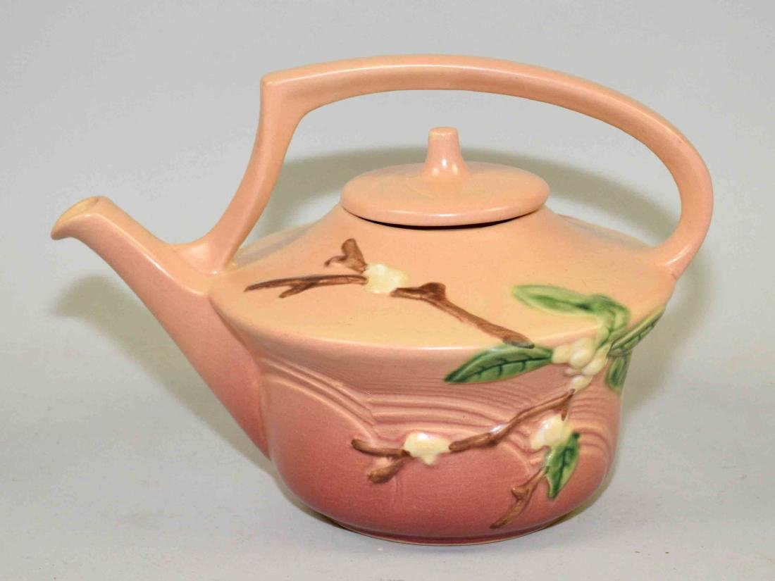 ROSEVILLE TEA POT, orange in color with floral