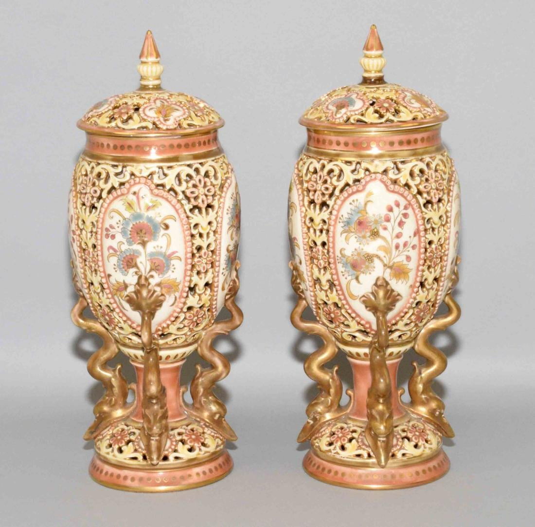 PAIR OF ZSOLNAY GLAZED RETICULATED CERAMIC LIDDED URNS,